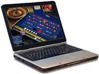 Laptop aperto con schermo su tavolo da roulette